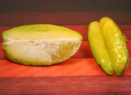 star fruit: star fruit on a wood table top