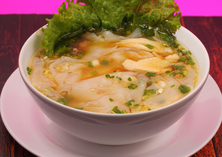 beansprouts: Glass noodle soup with chicken and beansprouts on a wood table top background Stock Photo