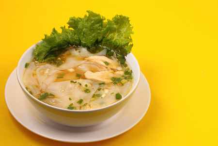 beansprouts: Glass noodle soup with chicken and beansprouts on a yellow background