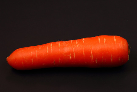 black background: isolated carrot on a black background