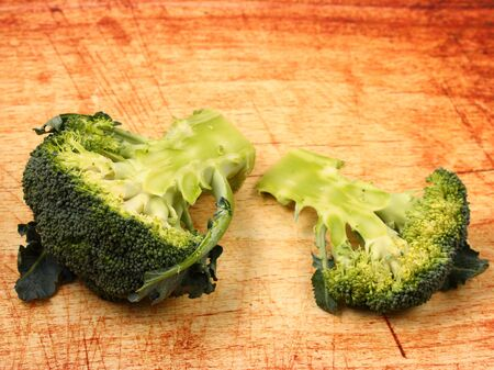 broccolli: isolated broccolli on a wood table top