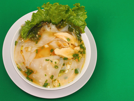 beansprouts: Glass noodle soup with chicken and beansprouts on a green background Stock Photo