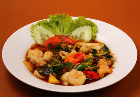 stir fry: thai style seafood stir fry with a brown background
