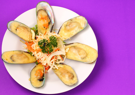 phuket food: new Zealand mussels in cheese sauce with a purple background