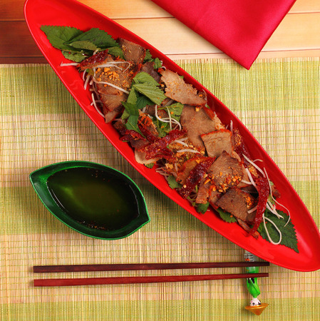 place mat: beef salad vietnamese style served on a bamboo place mat Stock Photo