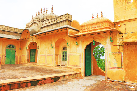 haunting: inside grounds in this fairy tale like fort was built in 1734 by Maharaja Sawai Jai Singh II. The construction of the fort was halted numerous times due to a haunting by the ghost of Nahar Singh Bhomia. The ghost and haunting stopped after the spirit was  Stock Photo