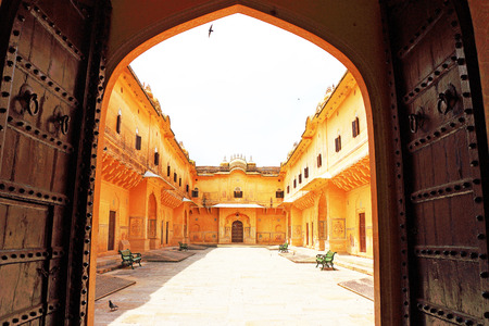garrison: courtyard in this fairy tale like fort was built in 1734 by Maharaja Sawai Jai Singh II. The construction of the fort was halted numerous times due to a haunting by the ghost of Nahar Singh Bhomia. The ghost and haunting stopped after the spirit was pacif