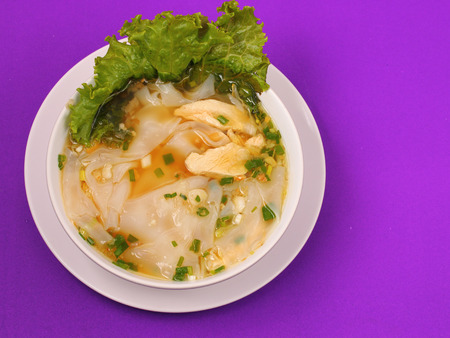 beansprouts: Glass noodle soup with chicken and beansprouts on a purple background