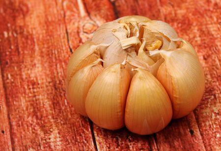garlic clove: garlic clove on a wood table top