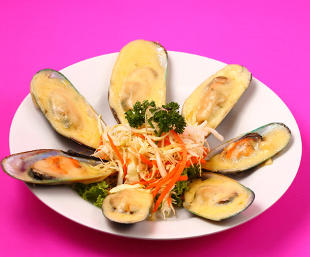 phuket food: new Zealand mussels in cheese sauce with a pink background