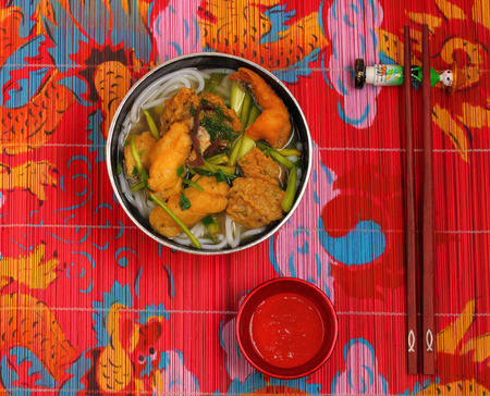 place mat: Vietnamese chicken noodle soup on a place mat