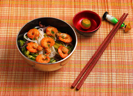 rice noodles: Vietnamese shrimp and rice noodles soup pho, served on a bamboo place mat