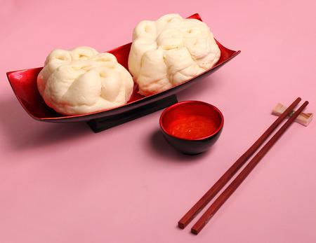 bao: banh bao pork bun Vietnam style on a pink background Stock Photo