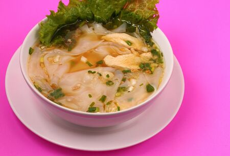 beansprouts: Glass noodle soup with chicken and beansprouts on a pink background