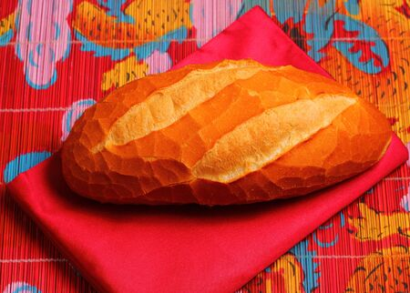 crust crusty: French bread on a typical Vietnam table setting