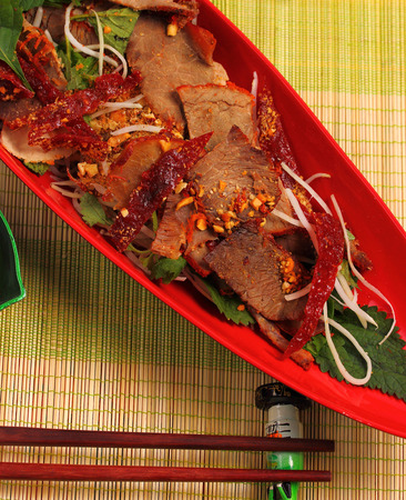 shiney: beef salad vietnamese style served on a bamboo place mat Stock Photo