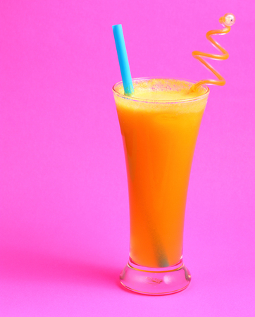 pineapple  glass: pineapple juice in glass on pink background Stock Photo