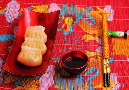 place mat: steamed shrimp dumplings served on a traditional bamboo place mat