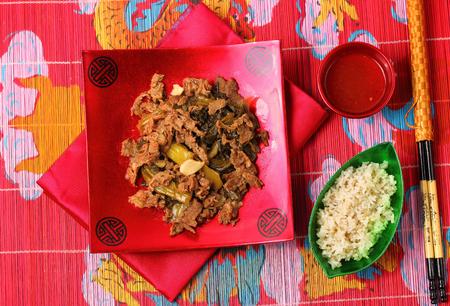 place mat: Vietnamese beef stir fry served on a bamboo place mat