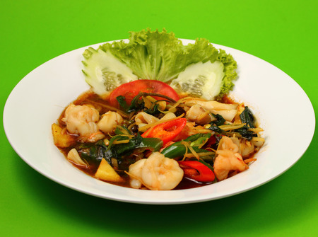 stir fry: thai style seafood stir fry with a green background