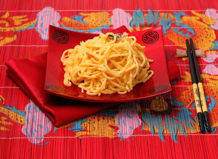 place mat: spaghetti  carbonara served on a bamboo place mat Stock Photo