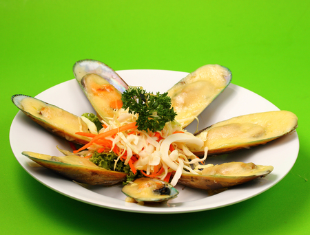 phuket food: new Zealand mussels in cheese sauce with a green background Stock Photo