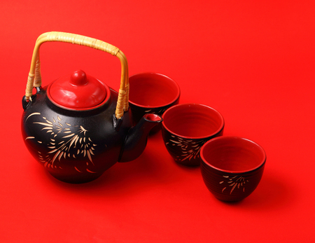 housewares: Asian tea set served on a red table cloth