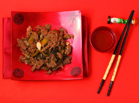 bo: Vietnamese beef stir fry served on a red background