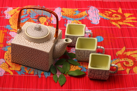 place mat: Asian tea set served on a bamboo place mat Stock Photo