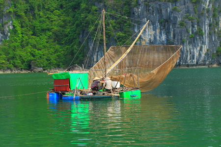 fish rearing: traditional vietnam fishing boat with net Stock Photo