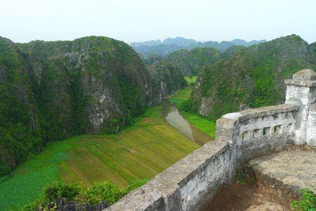 tam: tam coc river through rice paddi fields Stock Photo