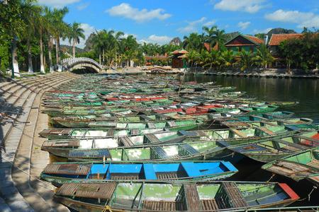tam: tam coc boat harbor full of tin boats