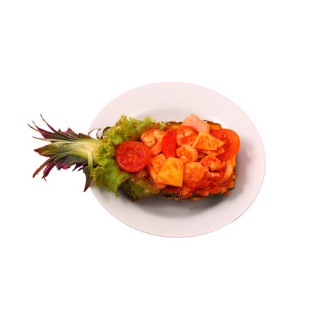 shrimp boat: Isolated sweet and sour shrimp served in a pineapple boat thai style