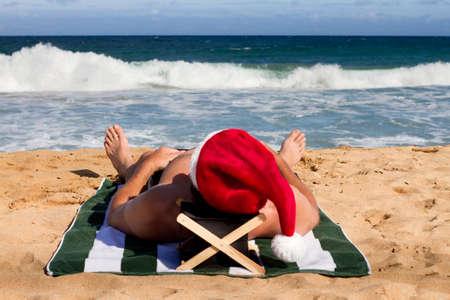 Santa Napping in the Hawaii Sun on the Beach photo