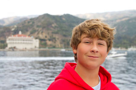 catalina: Teenager with the Casino of Catalina Island as the Ferry approaches Stock Photo