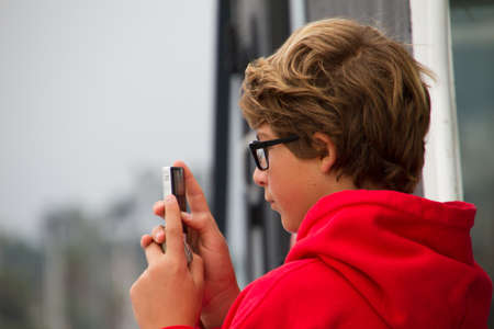 filming: Teenager wearing Glasses  Video Taping from a Boat