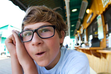 Fisheye portrait of a Teen Boy at a outside restaurant on the Peir photo