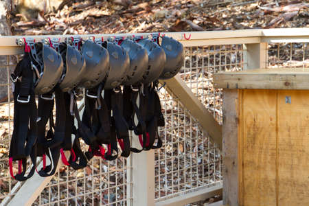 recreational climbing: Helmets Hanging outside on a fence for RocK Climbing Stock Photo