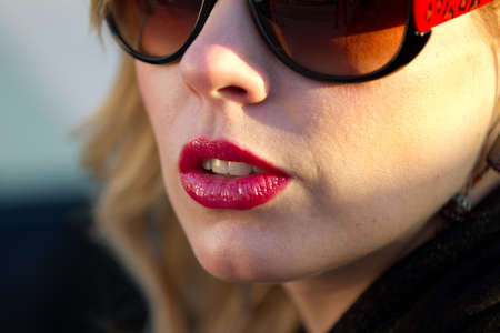 Outdoors Blond Woman closeup of Lips Nose and sunglasses Stock Photo - 11142598