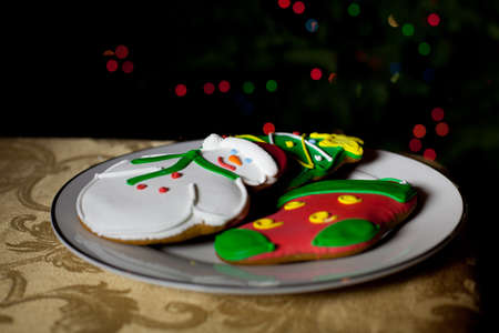 Christmas Cookies in front of the Christmas tree with bokeh from the lights photo