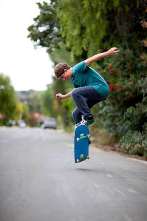 skateboarding: Teenager Skateboarding getting AIr