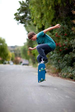 Teenager Skateboarding getting AIr