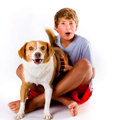 A boy and his Dog with Similar expressions photo
