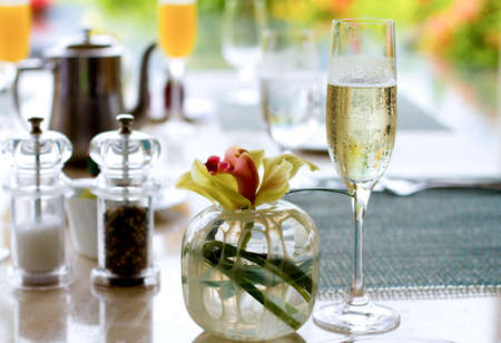 champagne flutes: Champagne Brunch table setting at outdoor restaurant
