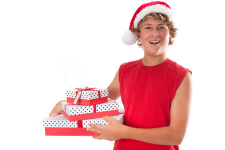 Cute Teenager giving a gift wearing a Santa Hat photo