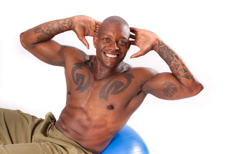 Athletic Man doing Abdominal work on a exercise Ball photo