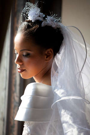 Beautiful Bride looking out a window Stock fotó