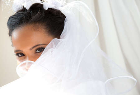 Beautiful Bride looking out a window Banco de Imagens