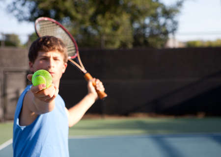 Teenager playing Tennis with determination photo