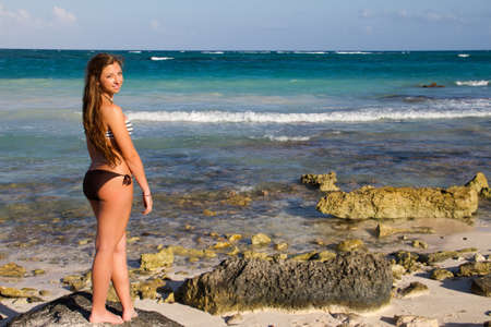 Young beautiful women in a Bikini on the sunny tropical beach photo
